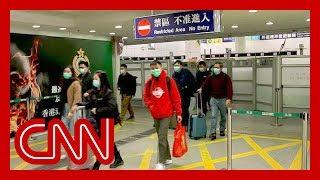 Hong Kong restricts border to contain Wuhan coronavirus