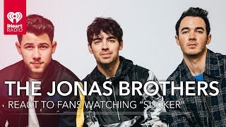 """The Jonas Brothers React To Fans Watching """"Sucker"""" Video For The First Time!"""
