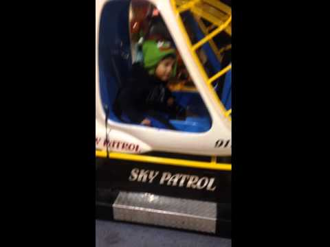 Adorable baby gets carsick on rocking helicopter.