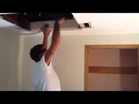One Man cuts in a attic access  and cuts in a ceiling fan box.
