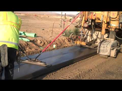 Construction of Concrete Sidewalk by Extrusion Method