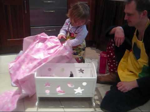 Unwrapping the dolls cot