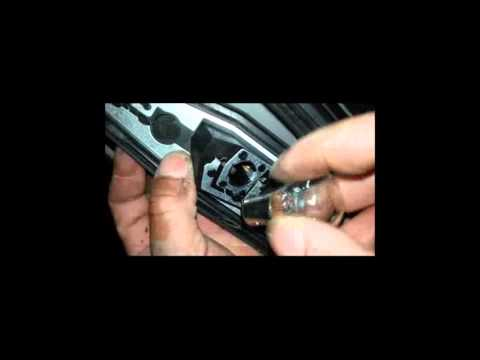 how to replace Corsa brake light bulb