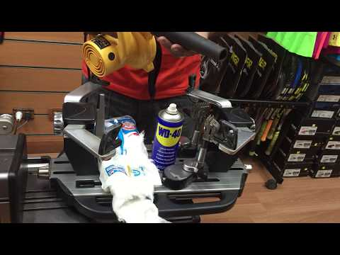 stringing tennis racket (how to clean your stringing machine)