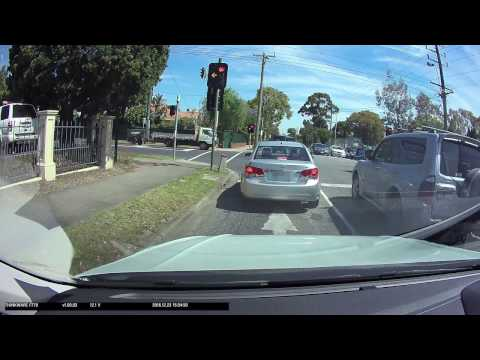 Idiot turning from wrong lane gets flashed by red light camera