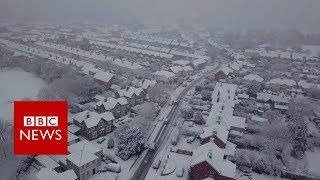 Drone footage captures snowy scenes - BBC News