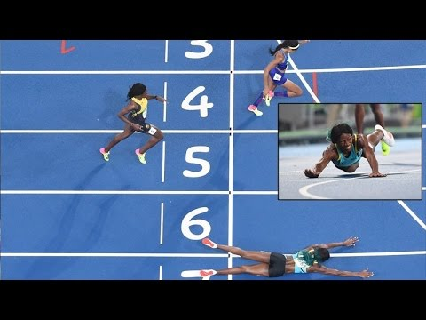 Runner Slides Head-First To Cross Finish Line Taking Olympic Gold