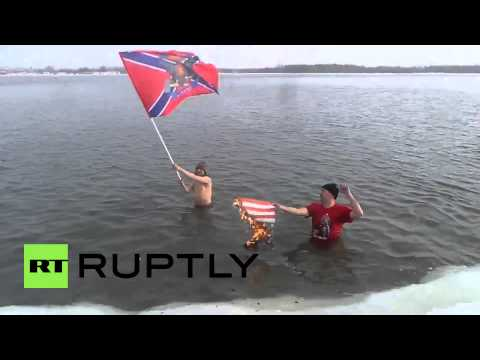Russia: See Siberian ice-swimmers BURN US flag for Donbass in FREEZING waters