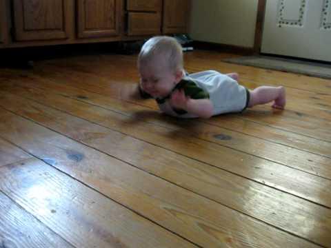 Baby crawls military style
