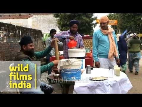 Bhang being prepared for consumption in India, at Sikh festival