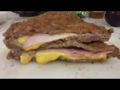 Bistec empanizado  relleno de jamon y queso. receta
