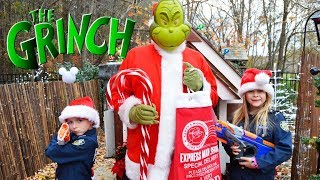 Grinch tricks Buddy the Elf featuring The Assistant a silly funny kids video at Christmas town