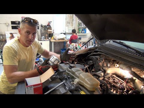 Ford PowerStroke 7.3 fuel filter re and re and fuel priming.  Save money and get better mileage!