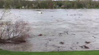Debris pulled along in flooded Sanford Lake