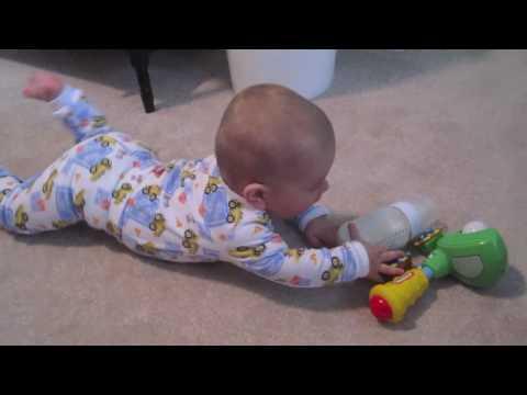 Baby John starting to crawl - 6 Months