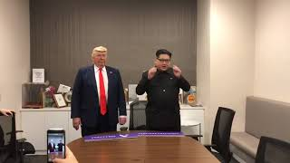 Donald Trump and Kim Jong Un impersonators shake hands