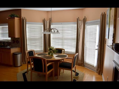 Dressing a Bay Window with Blinds and Curtains Ideas