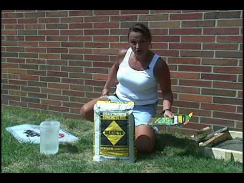 Woman Mixing Concrete
