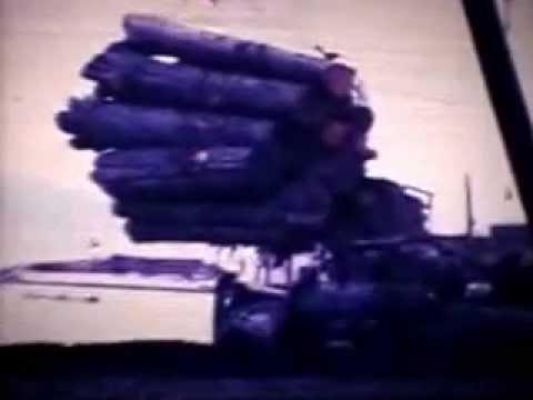 Load of logs getting ready to dump, Juskatla Queen Charlotte Island, 1978