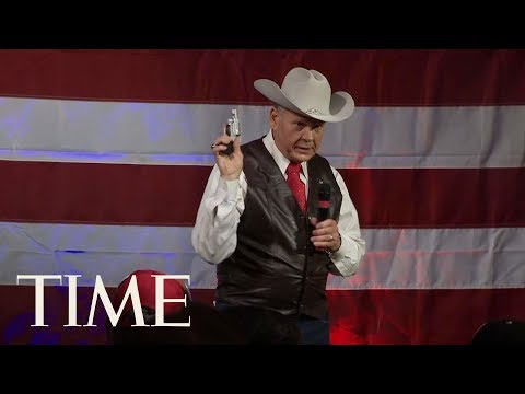 Roy Moore Pulls Gun Out On Stage During Alabama Rally Before Republican Senate Primary | TIME