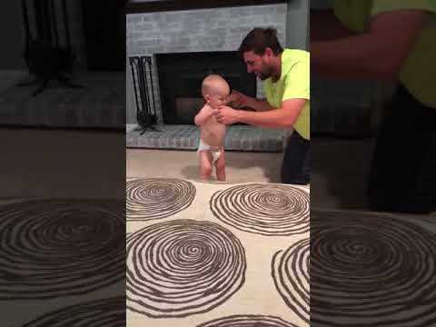 Dad Teaches Baby How to Walk