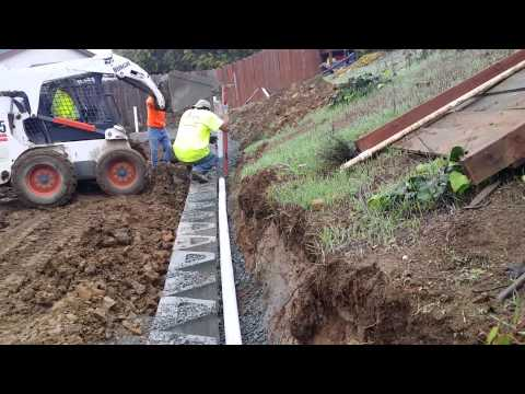 Adding Drainage Pipe & Drain Rock To Retaining Wall