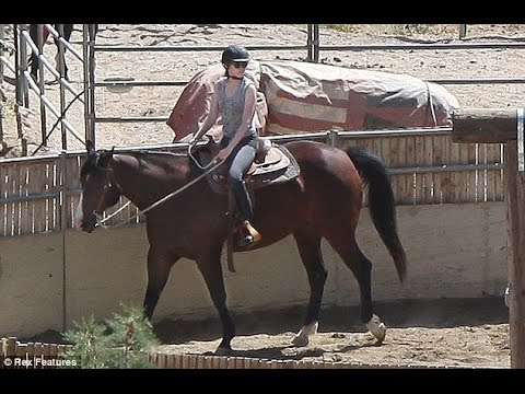 Hot to trot! Kristen Stewart braves the desert heat for a horse riding class ahead of new film role