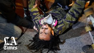 Protesters march through downtown L.A. protesting George Floyd's death for a second night
