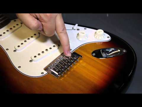 Restring an electric guitar. Replace a broken string.  Fender Strat style.