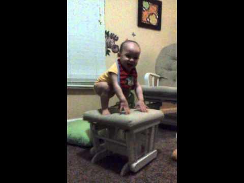 Baby balance in glider rocker , so cute!