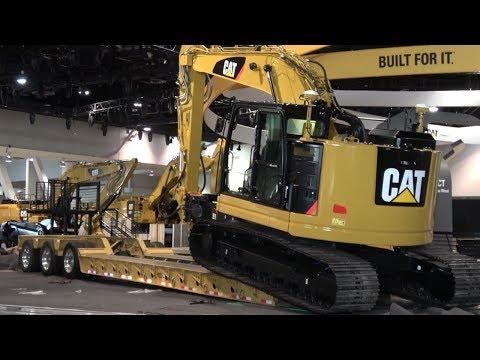 Caterpillar 325FL short radius excavator leaving Conexpo 2017