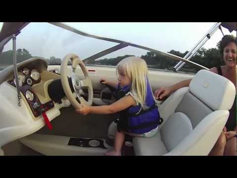 cutest baby driving ski boat!