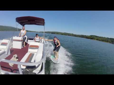 Wakesurfing behind a Pontoon Boat