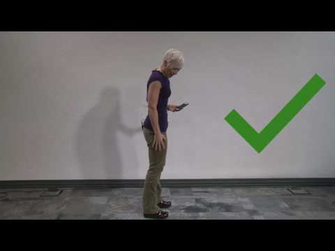 How to have good posture while standing and using your phone