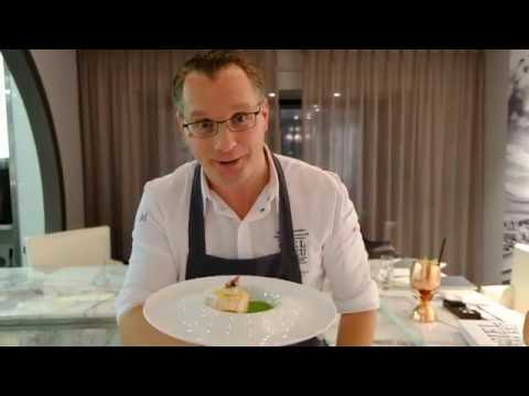 Chef Onno Kokmeijer presents his seabass dish at restaurant Ciel Bleu, Amsterdam, The Netherlands