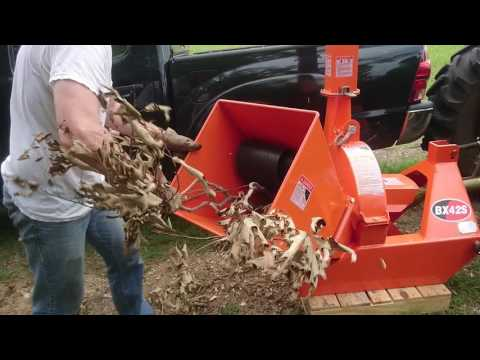 Making mulch for the garden with a PTO wood chipper