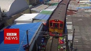 The train that drives through a market - BBC News