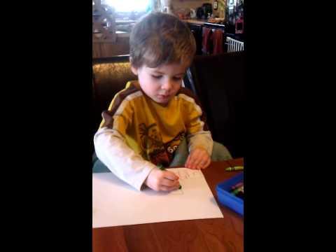 Autistic Child Writing the Alphabet