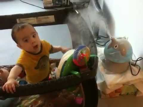 Baby Bradley Christian with the elephant humidifier by Crane