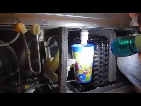 Samsung refigerator repair  freezer water pan wont drain