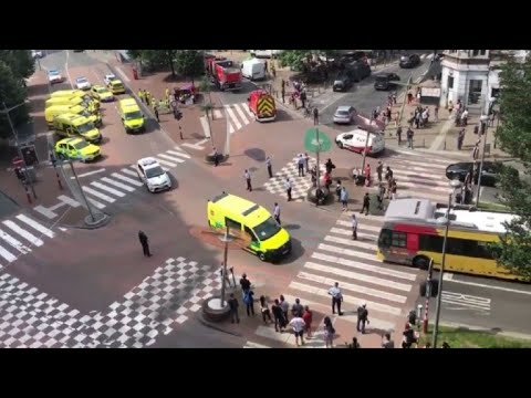 Police and ambulance on the site of the Belgium shooting
