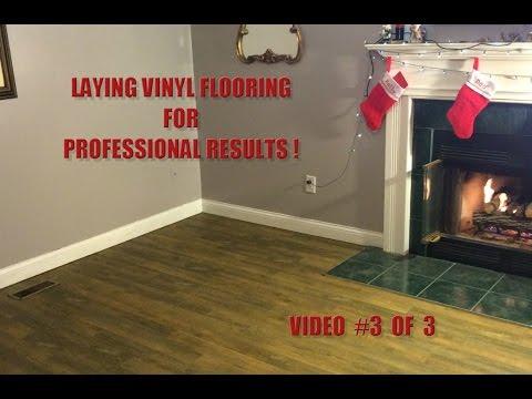 Installing Vinyl Peel 'n Stick plank flooring - video #3 of 3 - installing the tiles