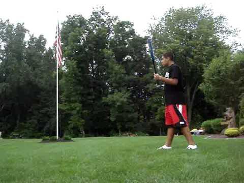 400 ft golf ball hit with a baseball bat