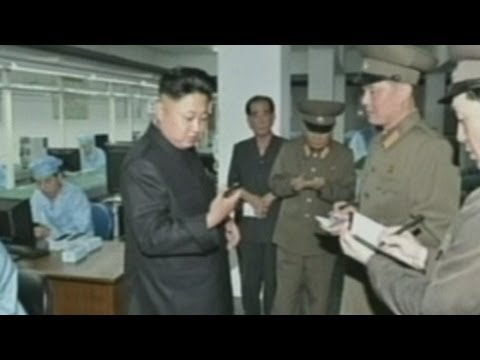 North Korean leader Kim Jong-un inspects mobile phone production line
