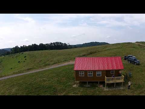 16 Acres with 649 SQ Ft Amish Built Cabin Drone Video