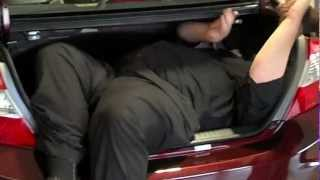 Testing the cargo capacity of the 2012 Honda Civic at Bob Montgomery Honda