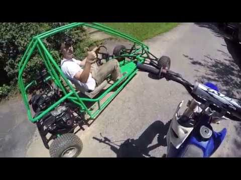 riding the dirt bike and the green go kart