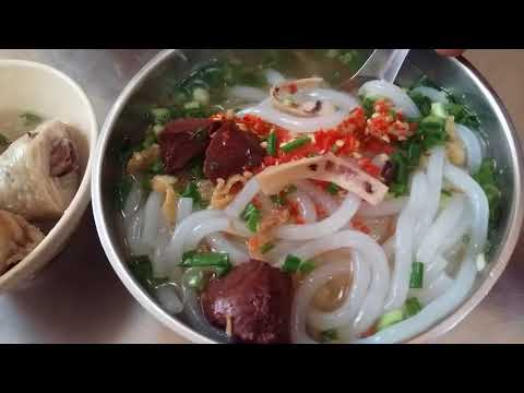 Saigon local food: Chicken thick noodle soup and Dried squid congee