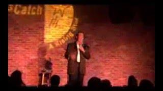 Comedian Manny Oliveira performing at