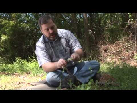 Bow drill friction fire with leaf string